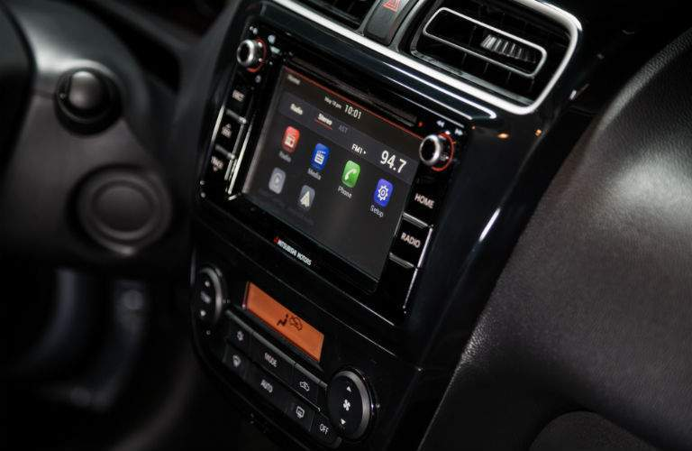 A close up photo of the infotainment system and climate controls in the 2018 Mirage G4.