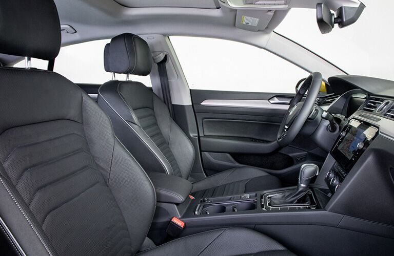 Interior view of the front seating area inside a 2019 Volkswagen Arteon