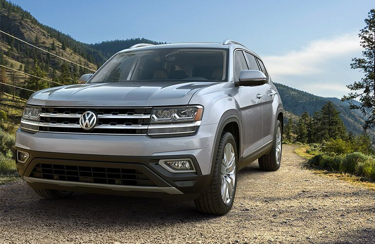 Exterior view of the front of a silver 2019 Volkswagen Atlas parked on a dirt road
