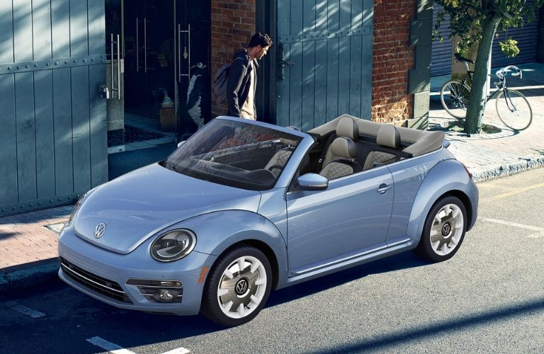 Exterior view of the front of a blue 2019 Volkswagen Beetle Convertible