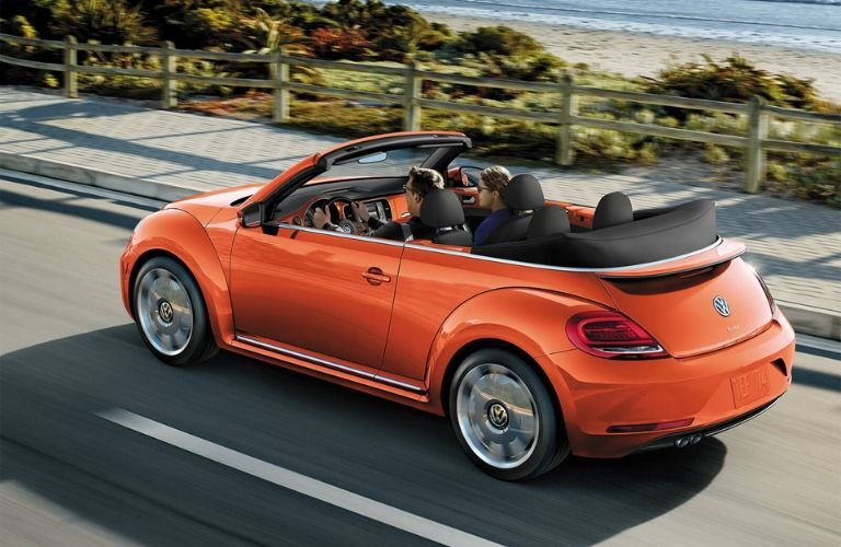 Exterior view of the rear of an orange 2019 Volkswagen Beetle Convertible