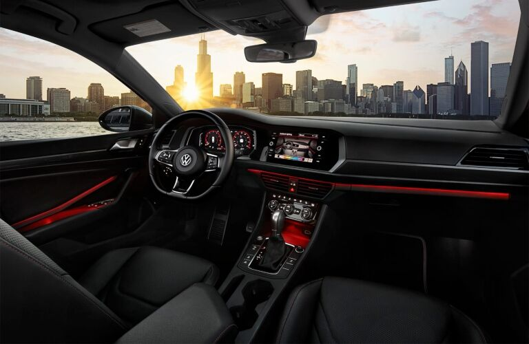 Interior view of the steering wheel and touchscreen inside a 2019 Volkswagen Jetta GLI