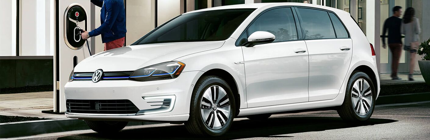 Exterior view of a white 2019 Volkswagen e-Golf parked at a charging station