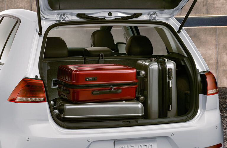Exterior view of the rear cargo area with the lift gate open on a white 2019 Volkswagen e-Golf
