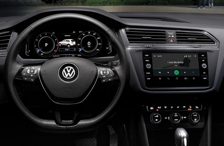 Interior view of the steering wheel and touchscreen inside a 2020 Volkswagen Tiguan