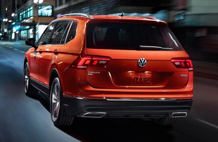 Exterior view of the rear of an orange 2020 Volkswagen Tiguan