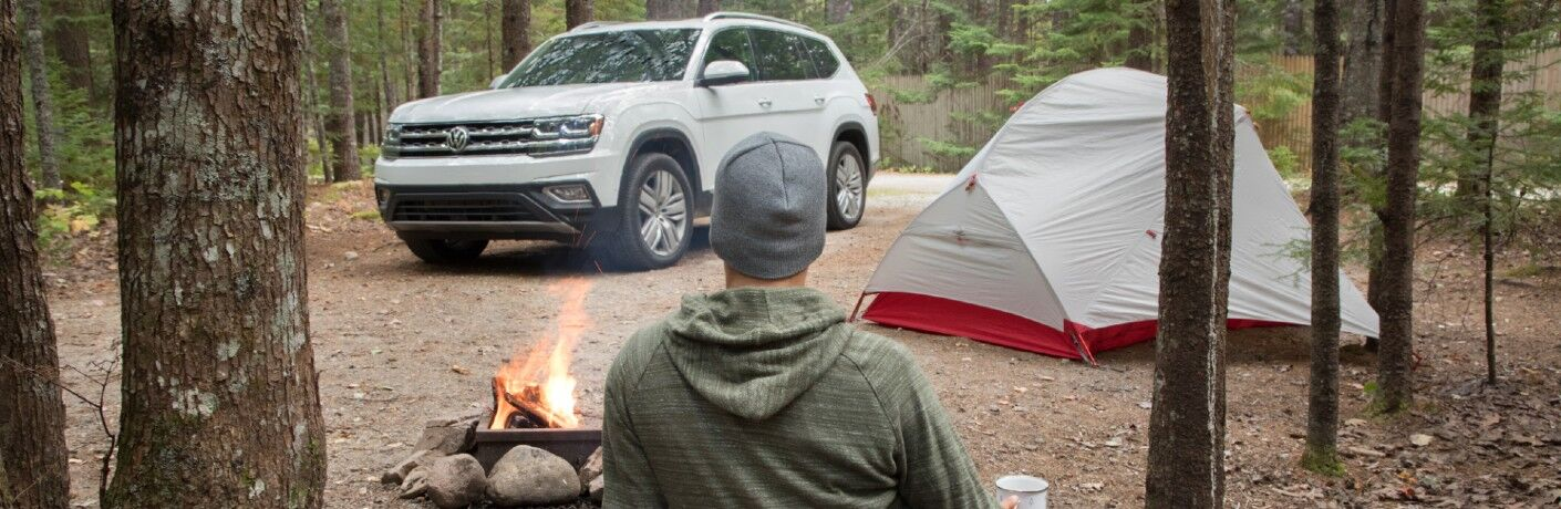 Driver tent camping with the Volkswagen Atlas