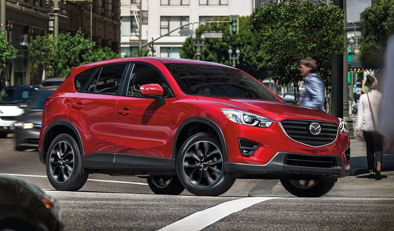 side view of the 2016 Mazda CX-5 driving in the city