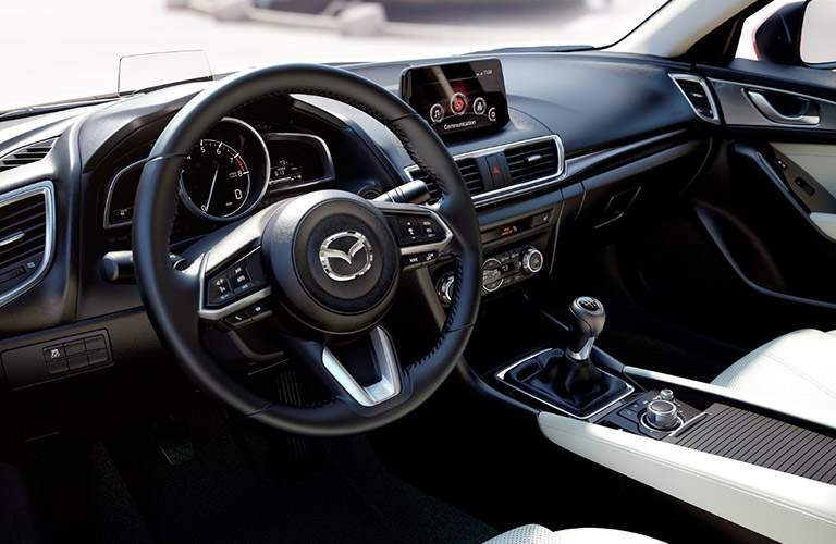 steering wheel and dashboard of the 2018 Mazda3