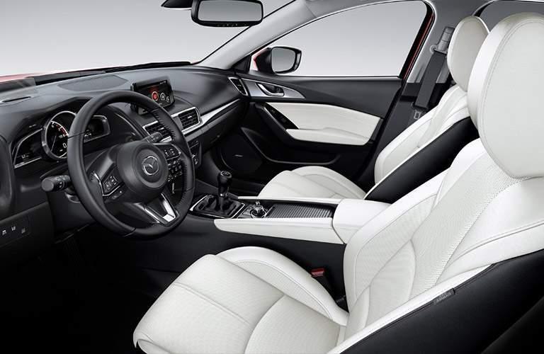 White and Black 2018 Mazda3 Front Seat Interior