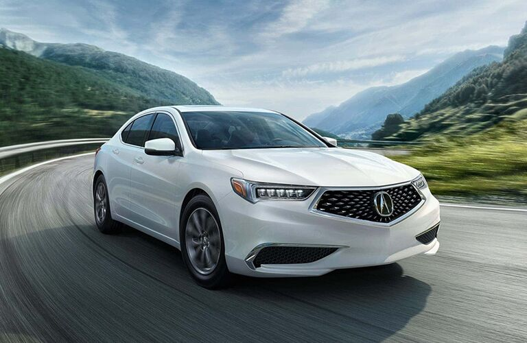 2019 Acura TLX in white driving on a mountain  road