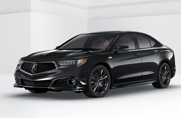 A front left quarter photo of a 2018 Acura TLX in a photo studio.