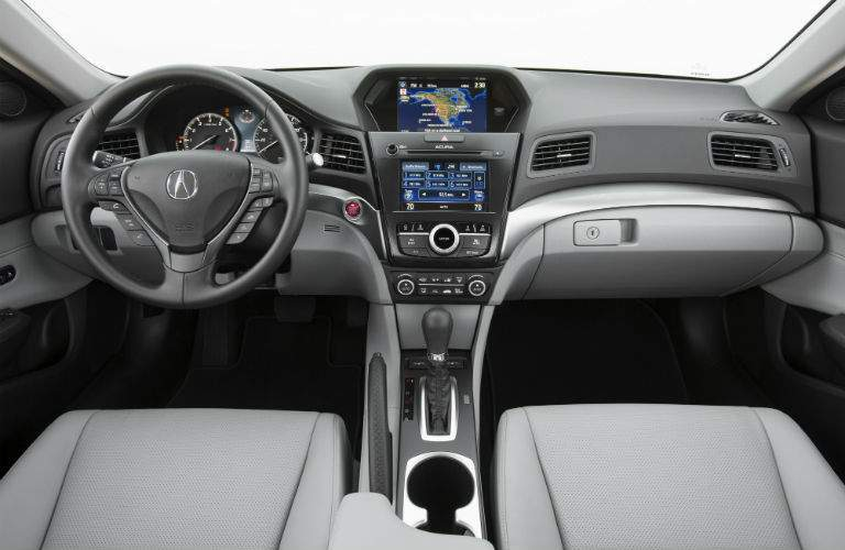 An interior photo of the dashboard and infotainment system of the 2018 Acura ILX