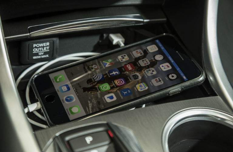 A close up photo of the wireless smartphone charging tray in the 2018 TLX
