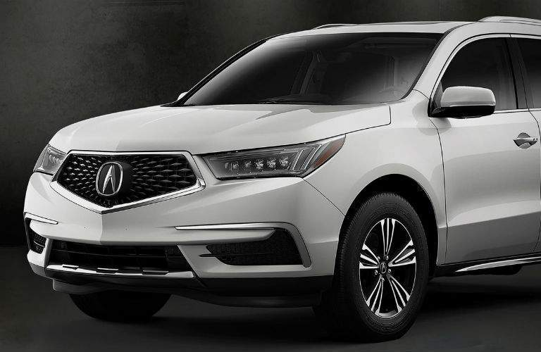 Front half of a white 2018 Acura MDX Standard