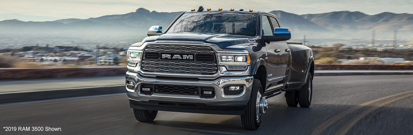 2020 Ram 3500 exterior shot driving away from mountainous city