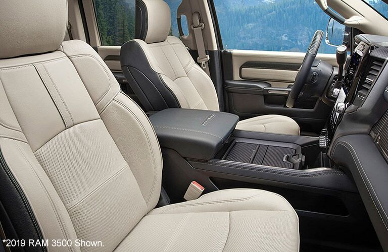 2020 Ram 3500 interior view of leather seats from through passenger window showing seats and console