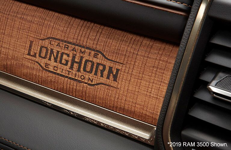 2020 Ram 3500 interior close up of Larmaie Longhorn Logo burned into wood