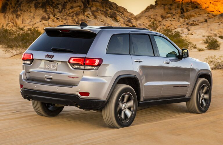 Silver 2018 Jeep Grand Cherokee driving in the desert