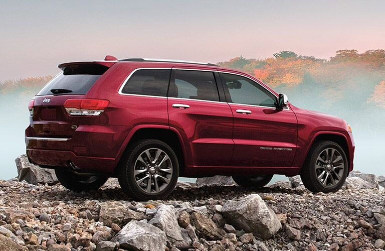 Red Jeep Grand Cherokee on rocks