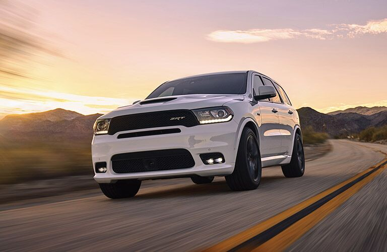 2018 Dodge Durango driving down a highway at sunset
