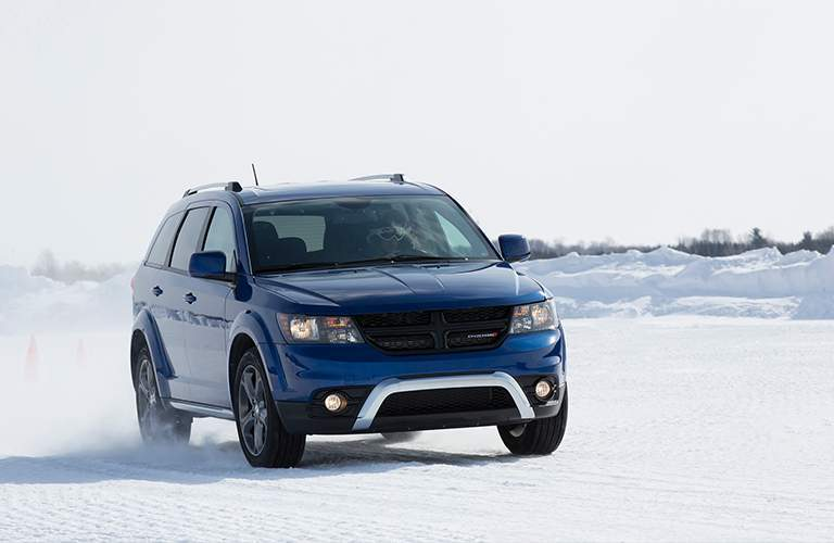 2018 dodge journey in contusion blue pearlcoat driving in snow