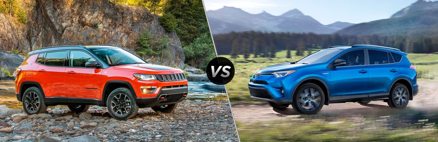 2018 Jeep Compass and the 2018 Toyota RAV4 with a vs sign