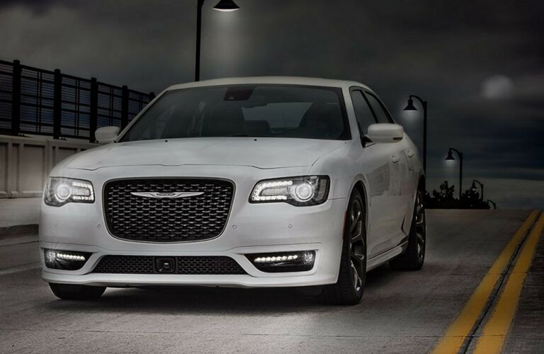 2018 Chrysler 300 driving down a dark road