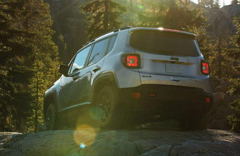 2018 Jeep Renegade parked on a rock in the forest