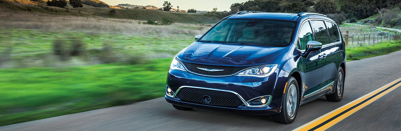 2019 Chrysler Pacifica Hybrid driving down a rural road