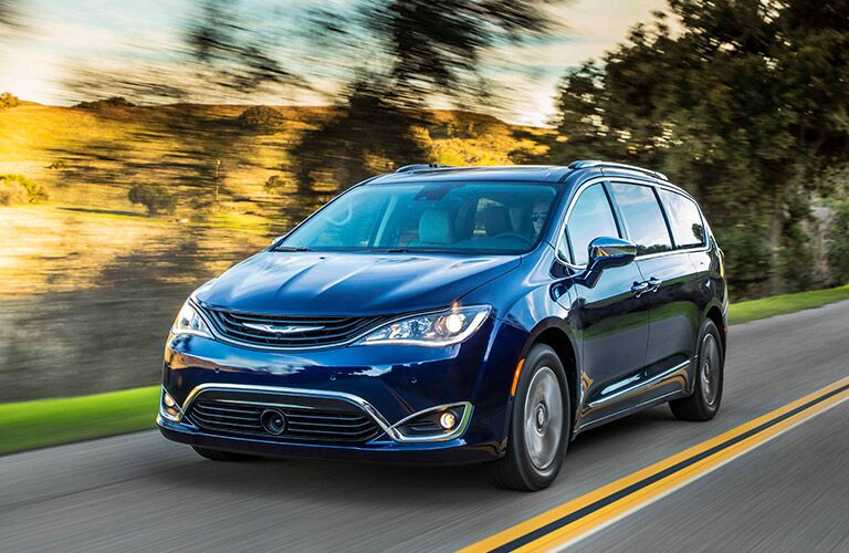 2019 Chrysler Pacifica Hybrid driving fast down a road