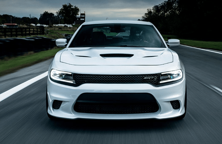 2019 Dodge Charger driving down a rural road