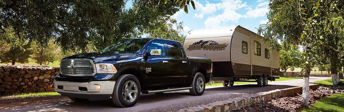 blue 2019 RAM 1500 Classic towing trailer