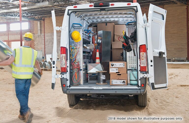 gear packed in back of white ram promaster