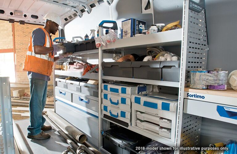 man working in back of ram promaster