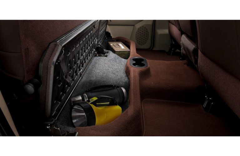 2019 Ram 1500 interior showing cargo spaces stowing flashlight and more