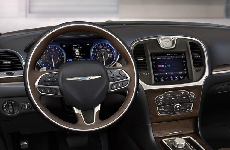 2020 Chrysler 300 interior shot showing dashboard screen steering wheel and some of driver door