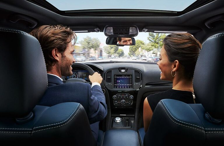 2020 Chrysler 300 interior shot from back row showing front headrests and heads of driver and passenger