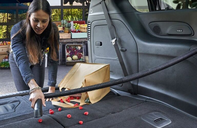 2020 Chrysler Pacifica interior shot showing woman vacuuming spilled groceries