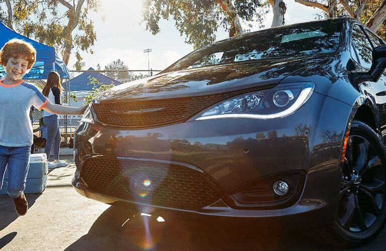 2020 Chrysler Pacifica close up of front headlight with perspective warp