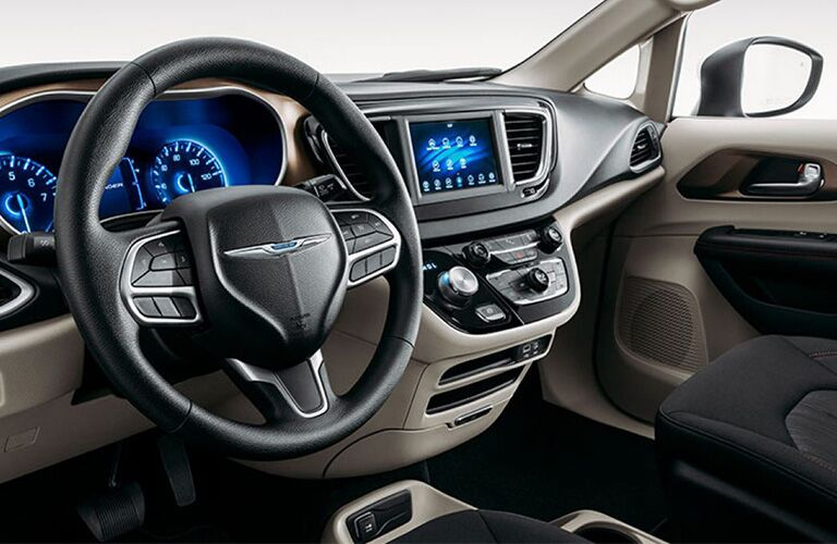 2020 Chrysler Voyager interior showing steering wheel and screen close up