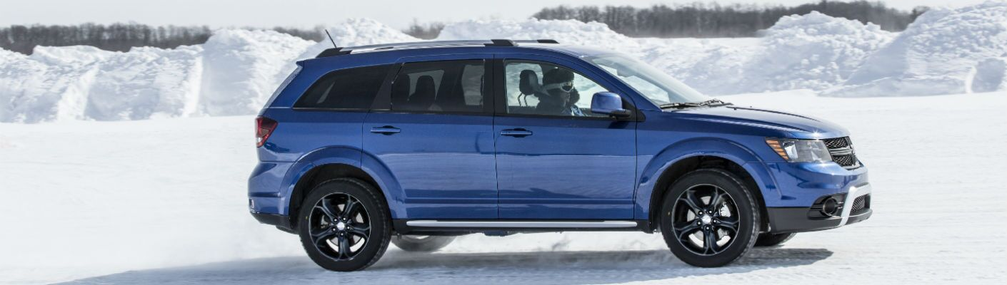 2020 Dodge Journey blue driving in snow
