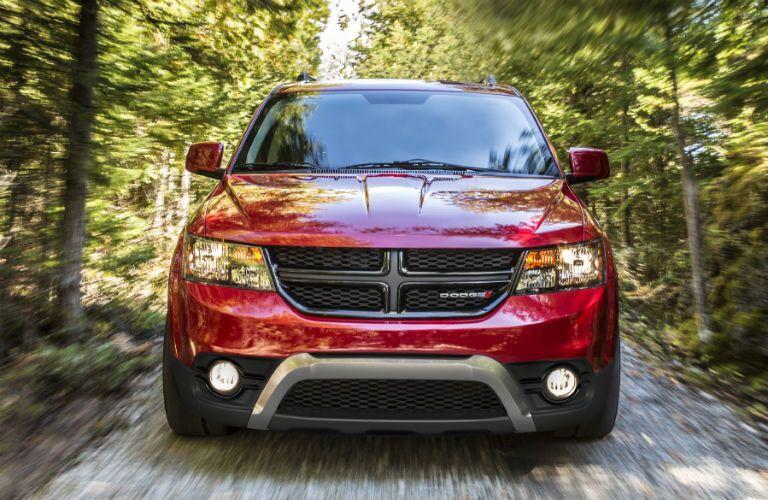 2020 Dodge Journey red driving toward shot on top of gravel