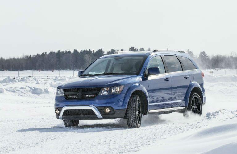2020 Dodge Journey blue quarter view in snow