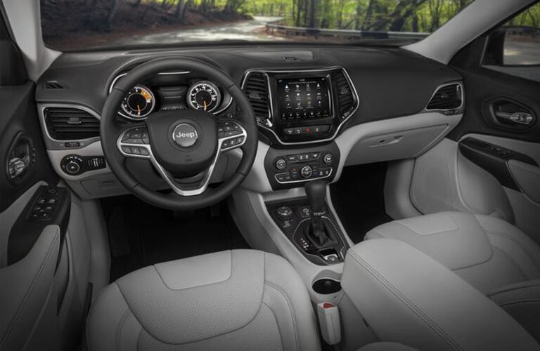 Front two seats and steering wheel of 2020 Jeep Cherokee
