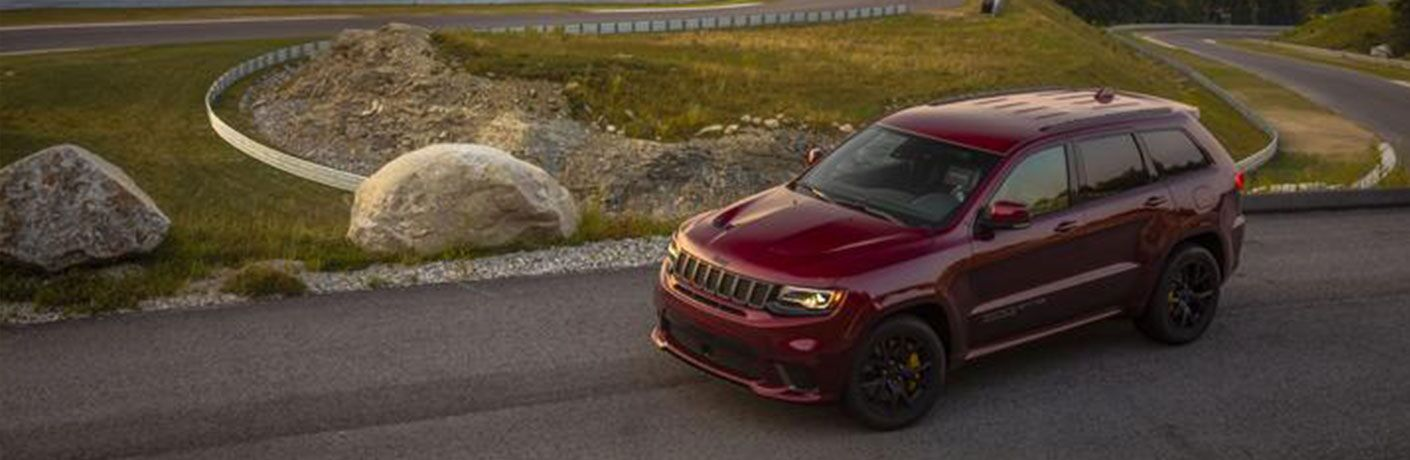 red 2020 Jeep Grand Cherokee driving on road