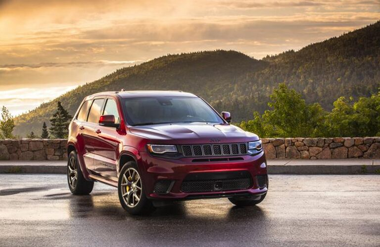 2020 Jeep Grand Cherokee red parked on concrete overlooking mountains