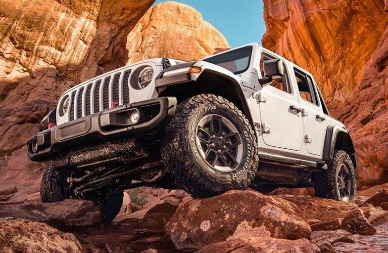 white 2020 Jeep Wrangler parked on rocks