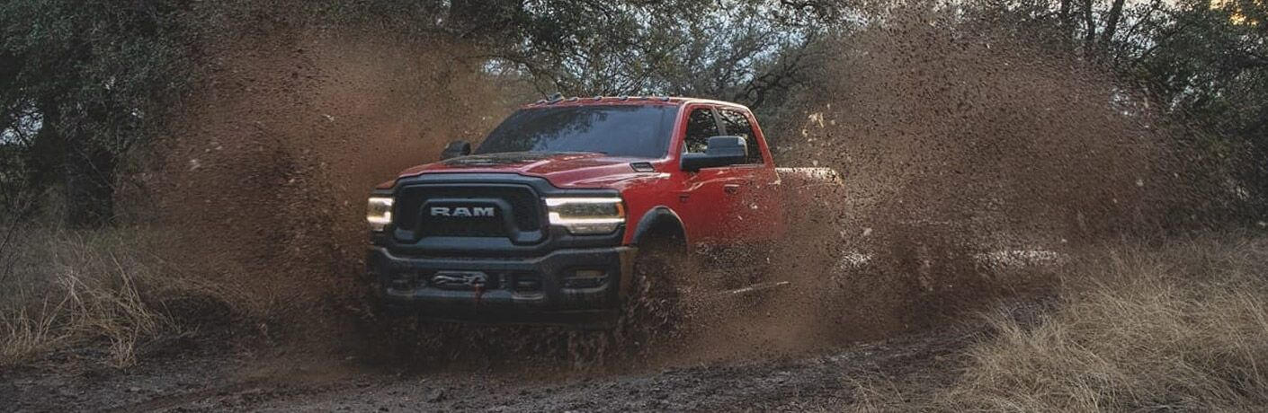 2020 Ram 2500 red driving through mud