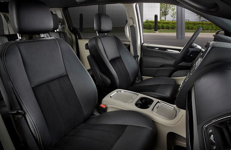 2020 Dodge Grand Caravan interior showing seats and center console through passenger window